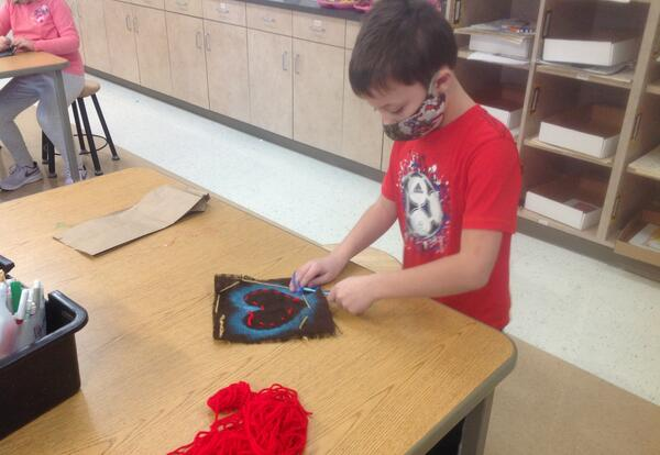 student works on art project