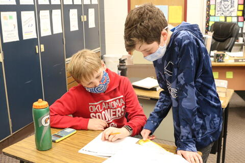 Students work in teams on math problems