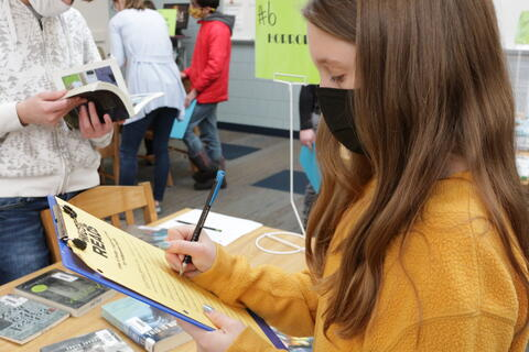 Students look at books in the library