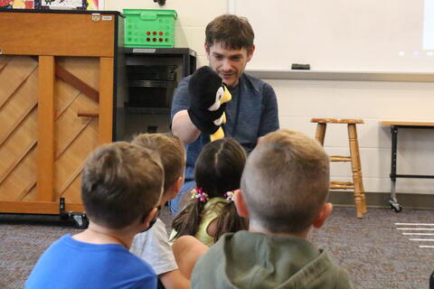 Teacher works with student at summer school