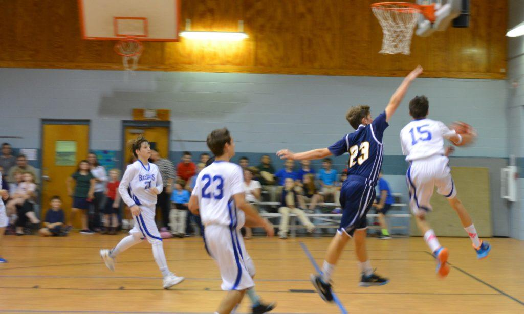 Boys' Basketball team in action