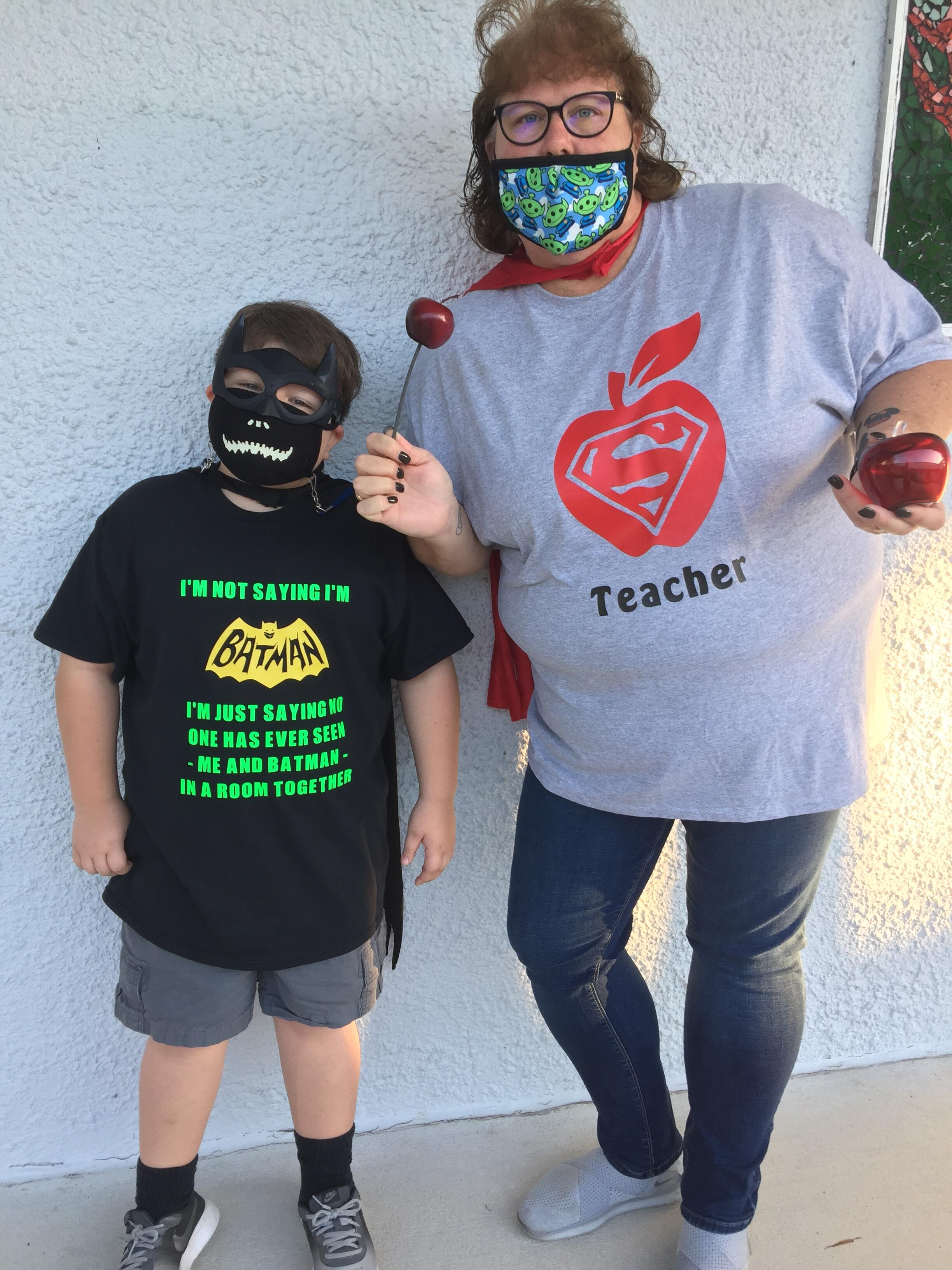 Teacher Mrs. White with Student dressed in super hero shirts