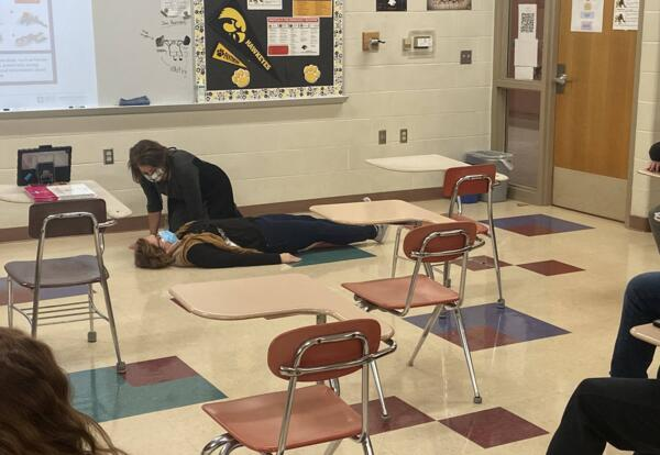 Mrs. Mitchell & Mrs. Nelson show students examples of how to ground themselves to calm down.