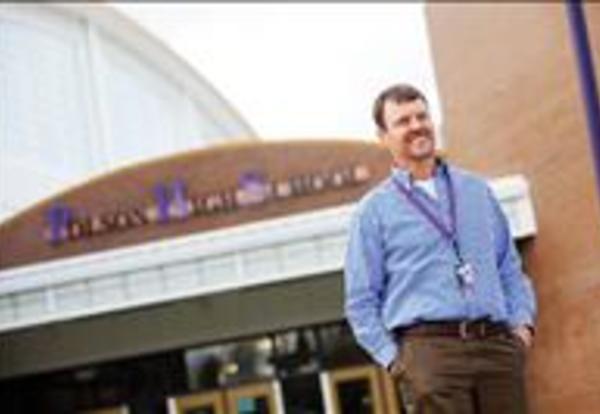 Superintendent Weltz in front of High School