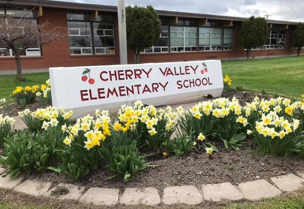 Front sign at Cherry Valley School with Flowers