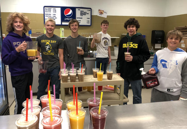 photo of web leaders making smoothies in the concession stand