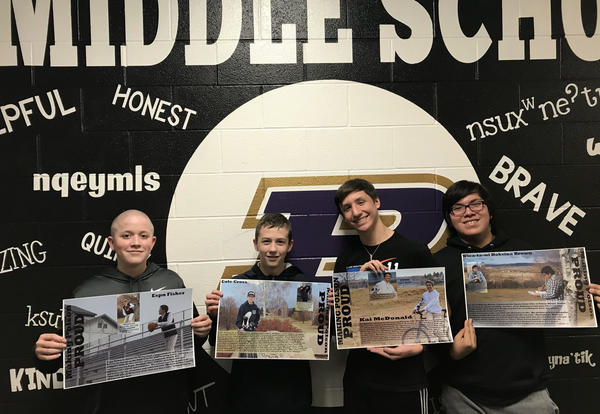 Middle School kids holding their Honor Posters.