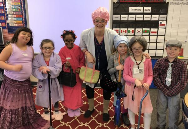 Image of teacher and students dressed up like centenarians