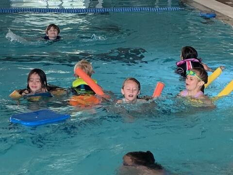 Kids swimming at the pool