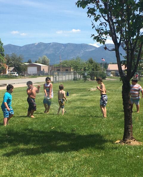 Kids at the sprinkler party