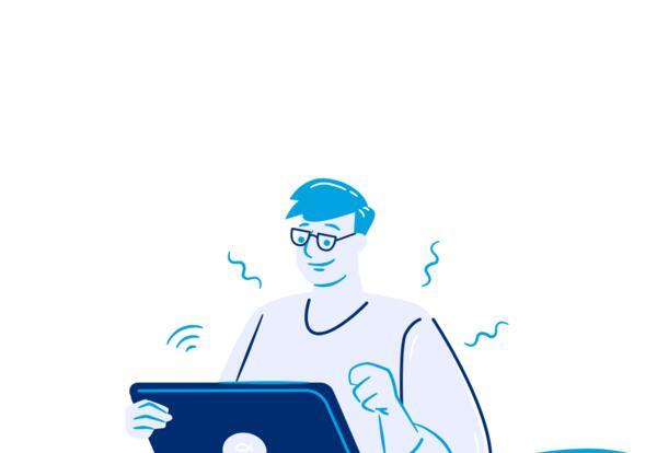 man sitting behind a laptop computer