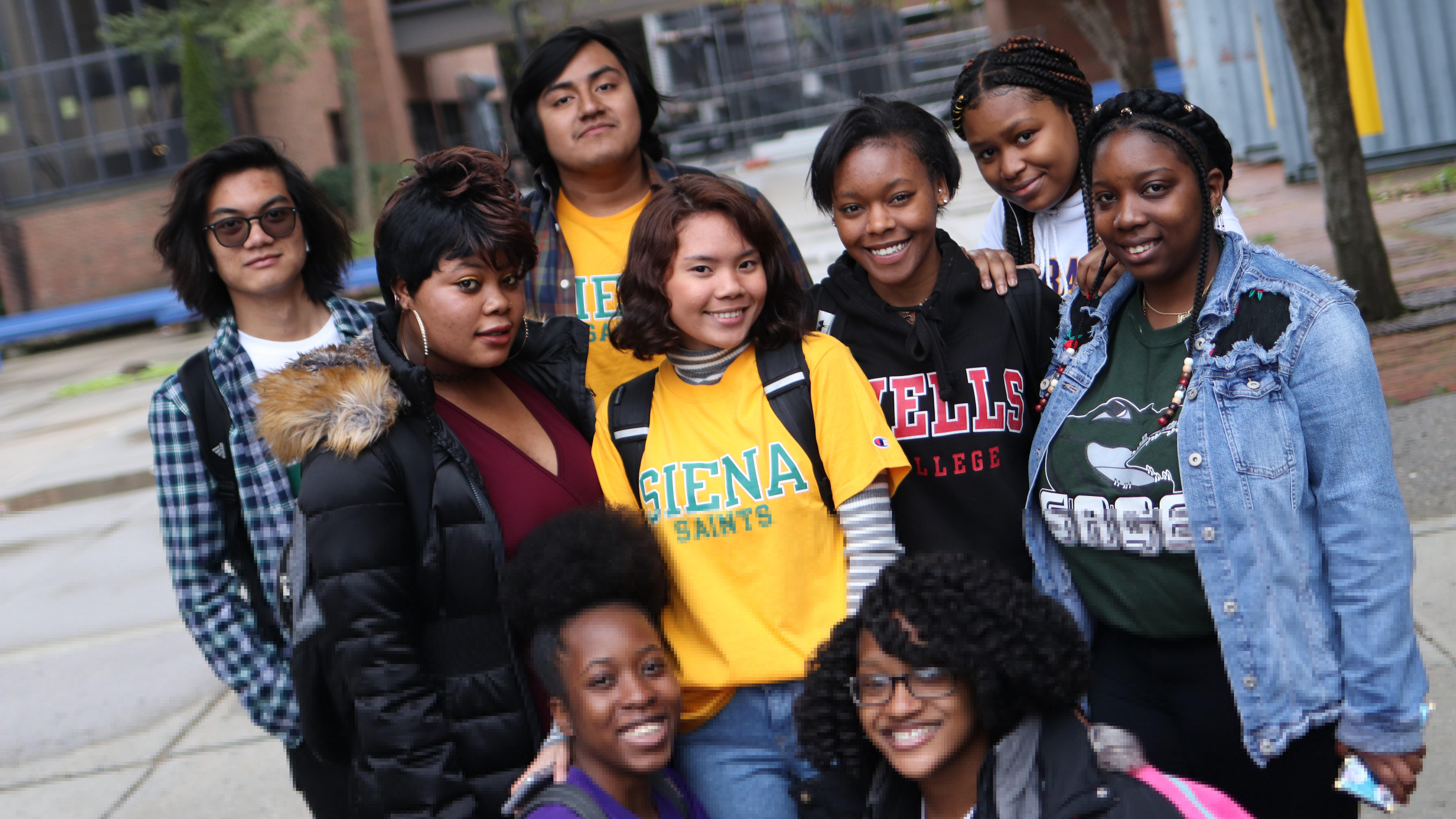 Group of students in their college shirts.