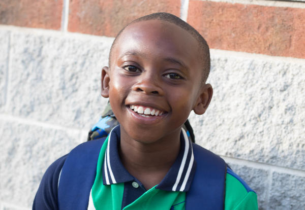 O'Neal student smiling as he heads into school.