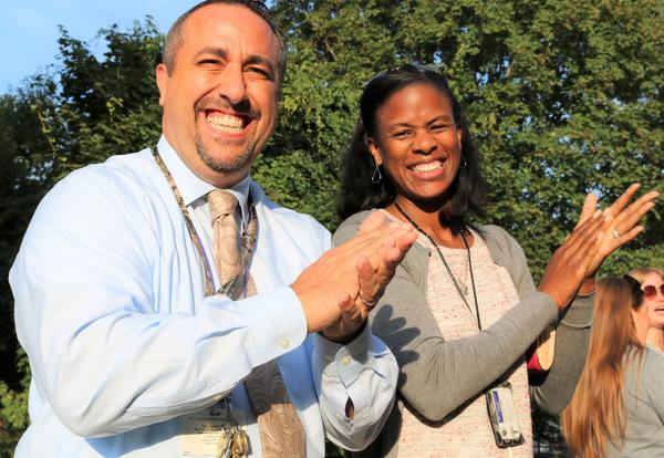 Principal Gabe Barbato and Assistant Superintendent Cecily Wilson welcome students