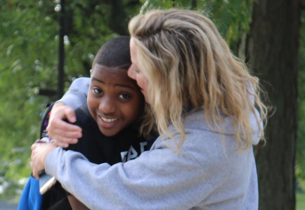 Arbor Hill teacher hugs returning student on first day.