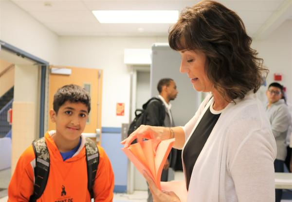 Principal Barber helps student with schedule on first day of school.
