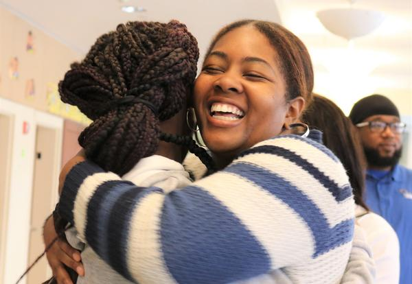 Clement staff member hugs returning student on first day of school.