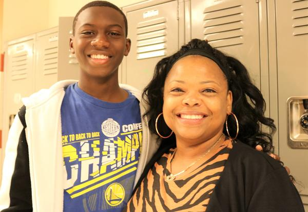 Principal Piper poses with a returning student at Myers Middle School.
