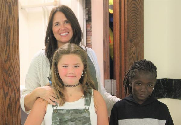 Teacher poses with two students on first day of school at Eagle Point.