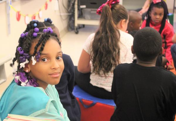 Third grade student poses in classroom on first day of school.