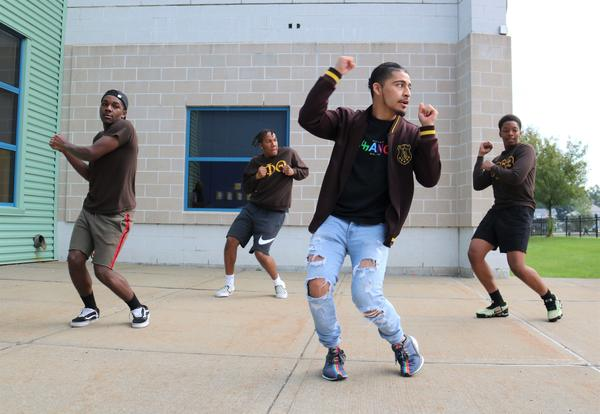 Members of UAlbany Iota fraternity perform during Myers clap-in.