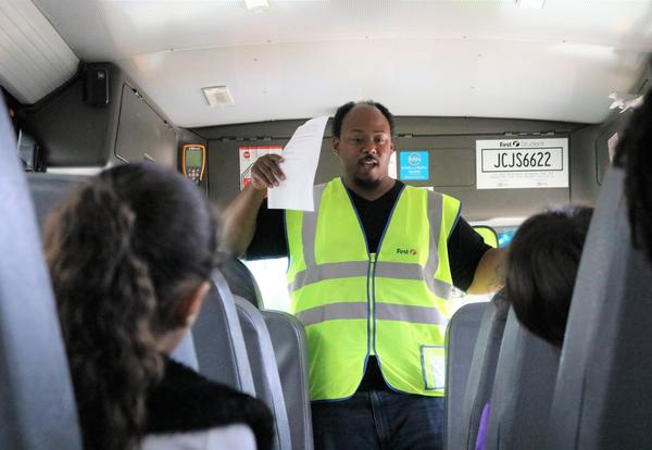 First Student driver discusses bus rules with Arbor Hill Elementary students.