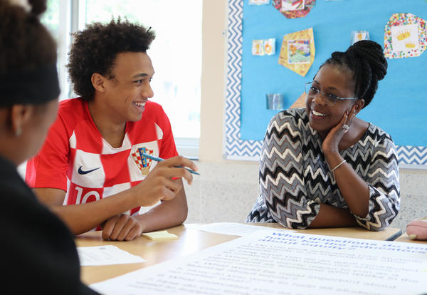 Superintendent Kaweeda G. Adams speaking with a student during a student panel on equity.