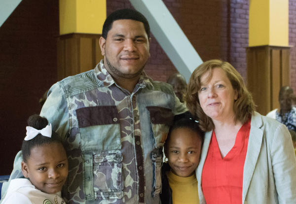 A Schuyler Achievement Academy dad and his daughters meet up with dad's former teacher.