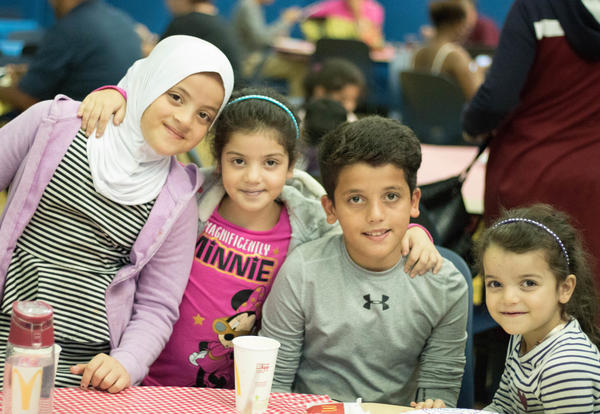 A family of three girls and a boy enjoys the back to school barbecue