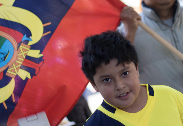 Boy with flag march in parade
