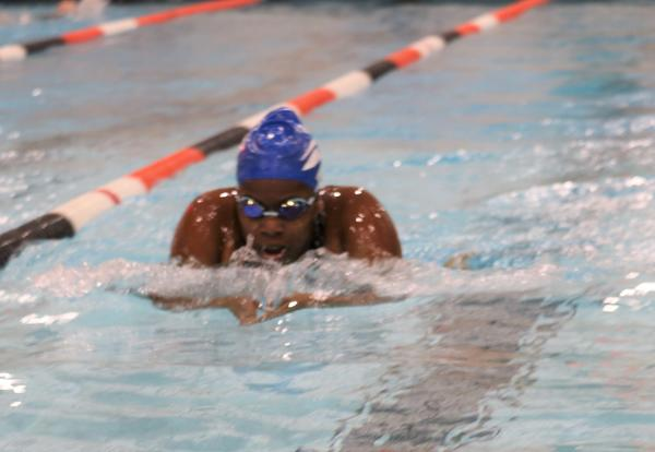 A Falcon swimmer races during a meet against Bethlehem.