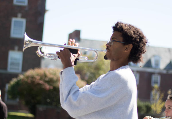 Student Themba Pieterse plays the trumpet