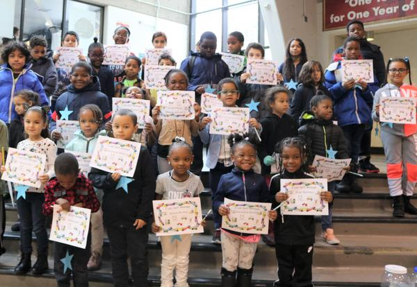 A group of Arbor Hill Elementary School students pose with their honor roll certificates.