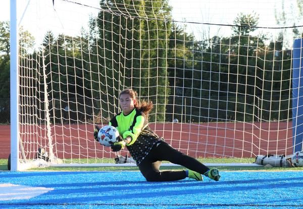 Falcon goalie Courtney Fish blocks ball.