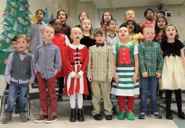 Eagle Point Elementary School students perform holiday songs during a first grade play.