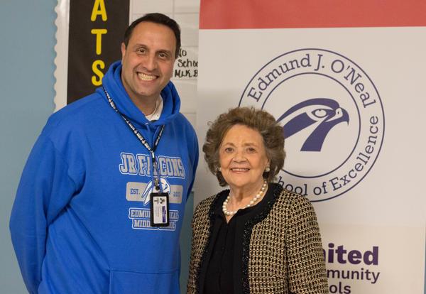 Principal David Bernsley and former First Lady Matilda Cuomo stand by the O'Neal logo