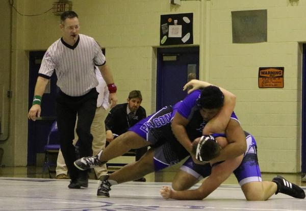 Two wrestlers compete in the Albany High School gym.
