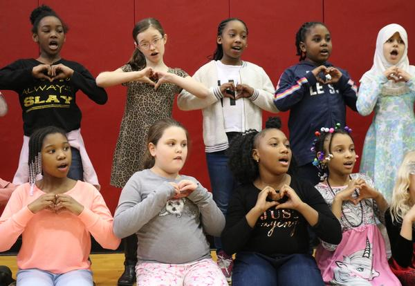 Third-graders perform a song in honor of Dr. Martin Luther King.