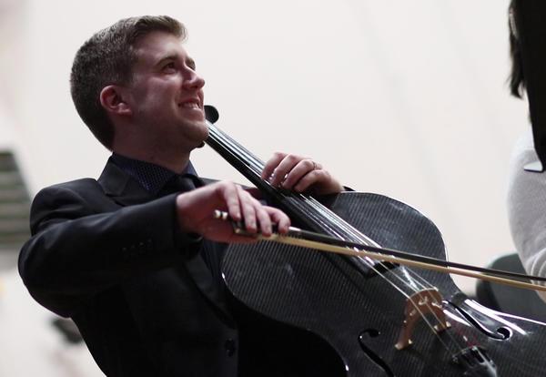 Music teacher Walter Theim playing the cello.