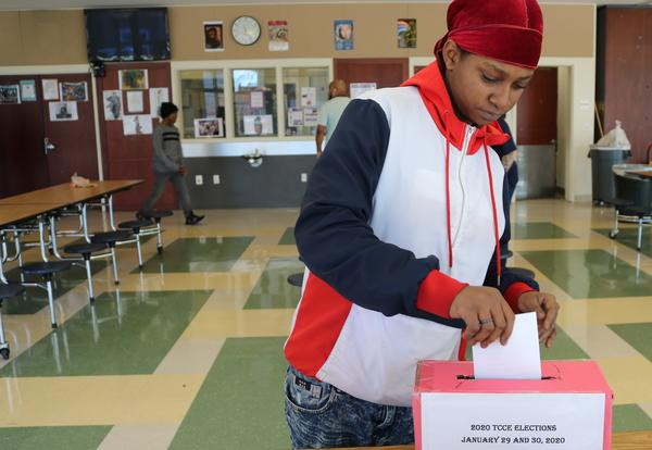 A student - who is also running for president - casts her vote in the Student Council election at Clement.