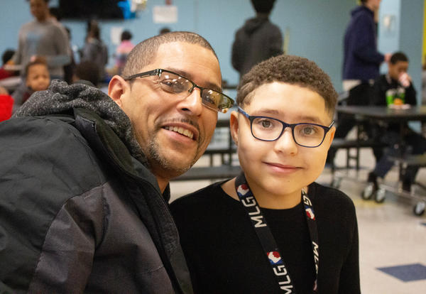 Father and son smile during honor roll celebration
