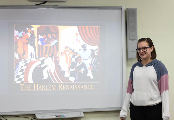 Student reads her book about Harlem Renaissance