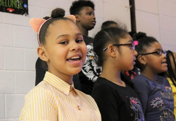 Fourth-graders sing during Arbor Hill Elementary's black history month assembly.