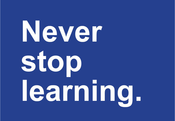 """White text that says """"never stop learning"""" against a blue background."""