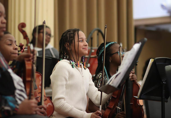 Orchestra students on stage during the All-City concert.
