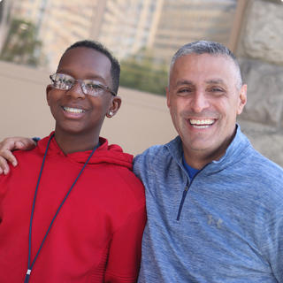 Principal Michael Paolino posing for a picture with a student.