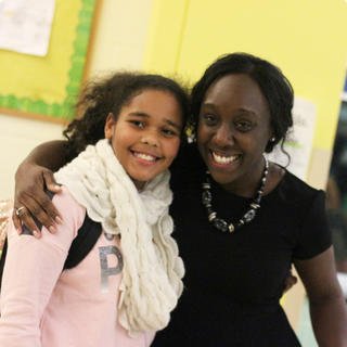 Principal Jasmine Brown posing for a picture with a student