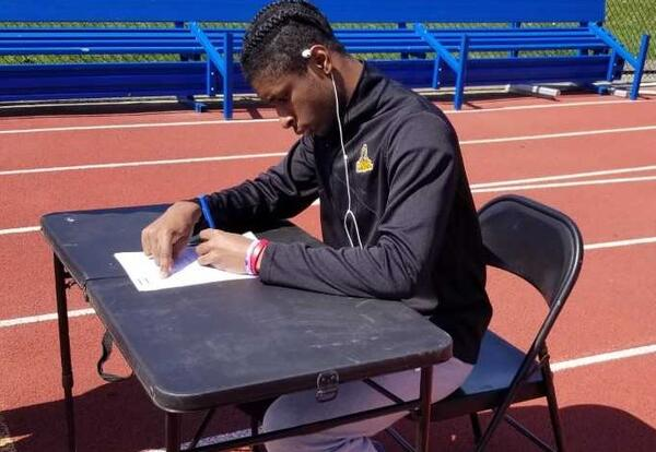 Andre Woods signs National Letter of Intent at Albany High track.