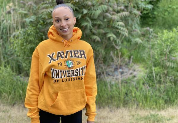 Senior girl wears Xavier College sweatshirt