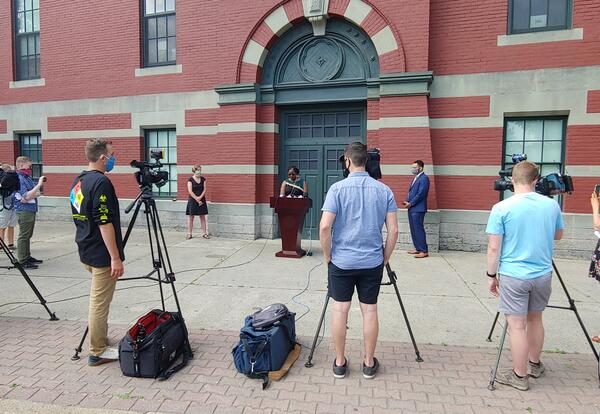 Photo of Superintendent Adams speaking at a news conference outside Schuyler Achievement Academy on June 19
